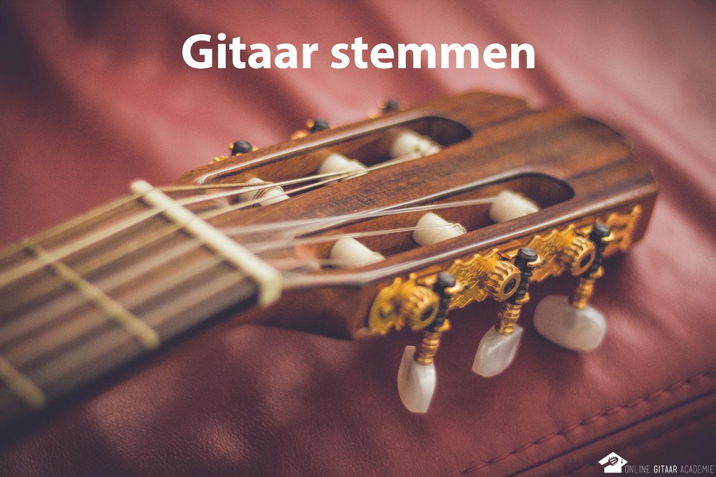 gitaar stemmen met de snaren laat de gitaartop zien waar je snaren moet aandraaien